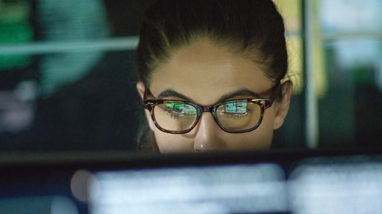 Women with glasses looking at a computer