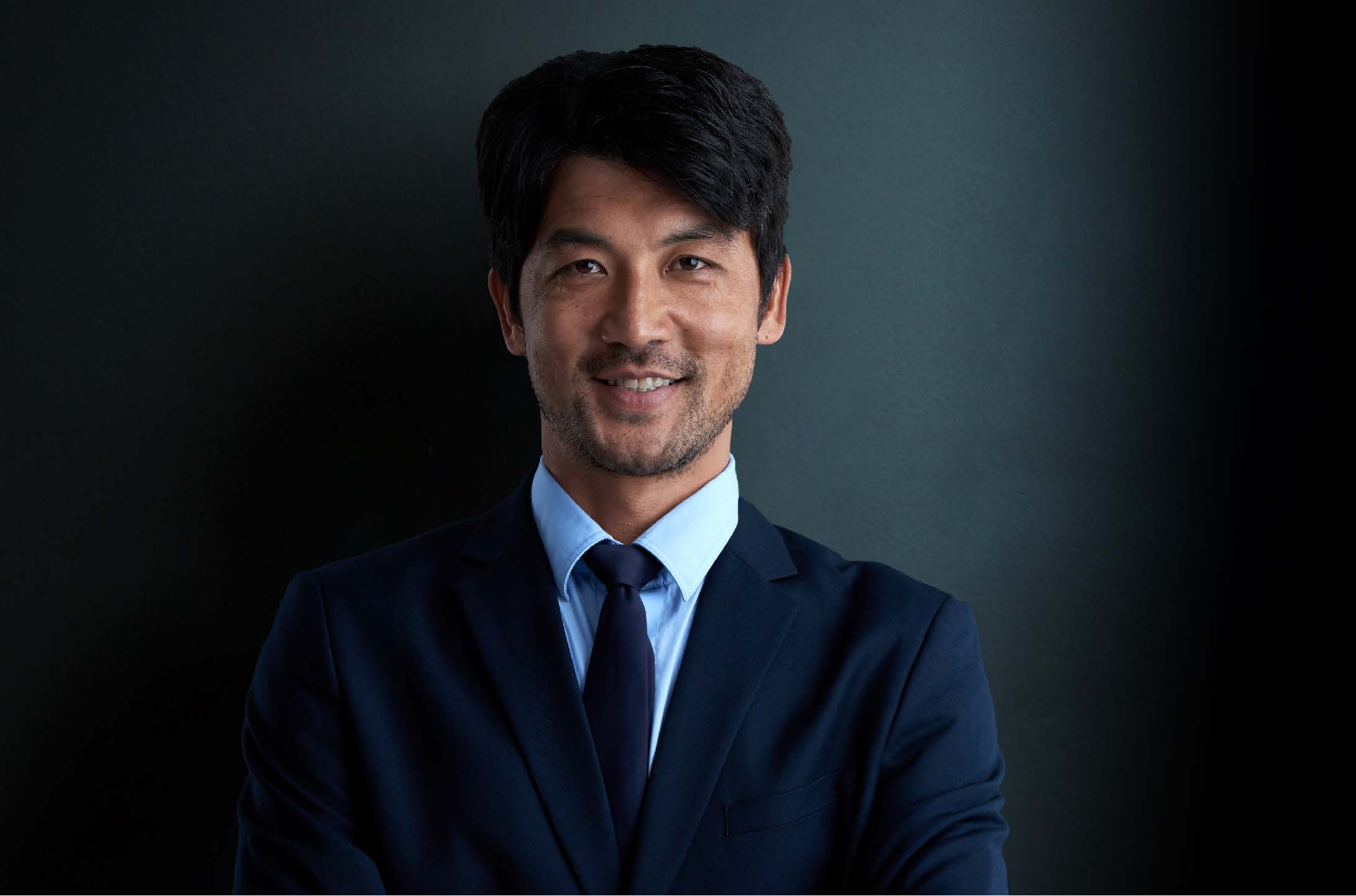 Asian man in business suit welcoming a conversation